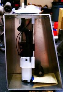 Custom fuel sump tank containing the OEM pump, sender, and regulator.