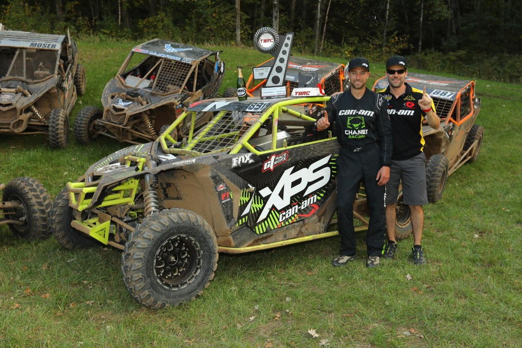 Kyle Chaney and Jeff Leclerc, Can-Am Race Department team leader, celebrated the first ever The Off-Road Championship (TORC) series championship for Can-Am after Chaney had three podiums (two wins) this weekend in Minnesota. (Photo by Harlen Foley)