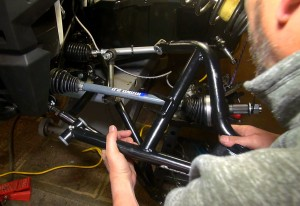 Here we happily slide in the new Super ATV arm into place.