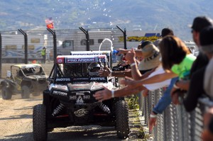 Scranton takes a victory lap after winning the UTV 1000 class and 1000/Unlimited Overall.