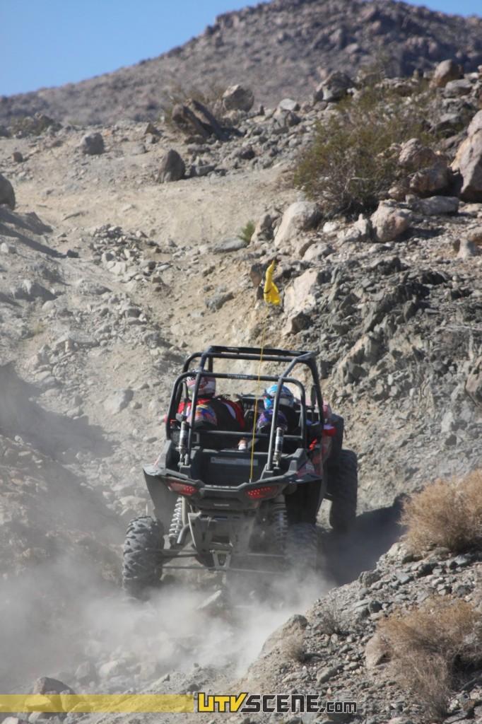 UTV Scene car making quick work of the hills in Johnson Valley