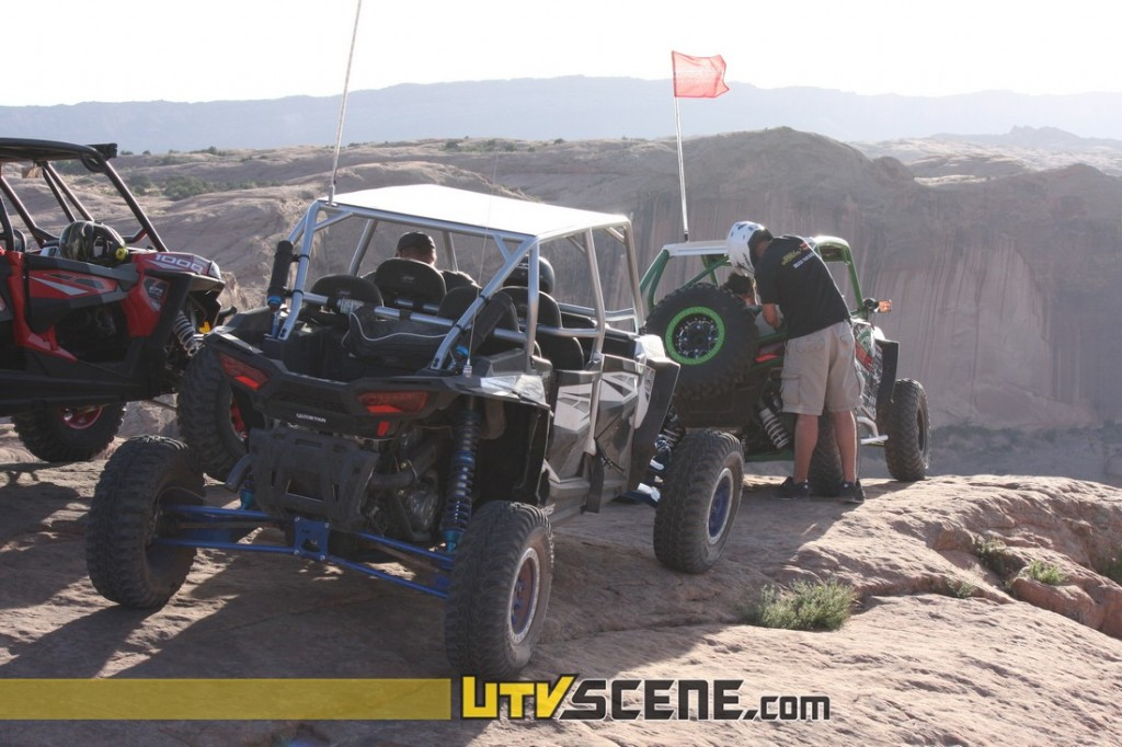 """We arrived on Wednesday afternoon and were quickly checked in, within minutes we were off on our first ride; it was the """"Ride for Wally"""". A large line of UTVs headed out on """"Hells Revenge Trail"""" and we were introduced to one of the most iconic of Moab slick rock routes. After an awesome & breathtaking ride we stopped at the trail's end on a gorgeous bluff overlooking the Colorado River hundreds of feet below. Many of Wally's good friends were on the ride and everyone gathered to share some kind words & funny stories for their friend Rick 'Wally' Wallace. Wally was an avid all around off roader and UTV enthusiast and recently lost his long hard battle with cancer. Wally obviously touched a lot of hearts, and made many friends within the UTV community. We never had the pleasure of meeting Wally but he sounds like a great and all around fun guy. It was an honor to be on the ride and share in the memory of him."""