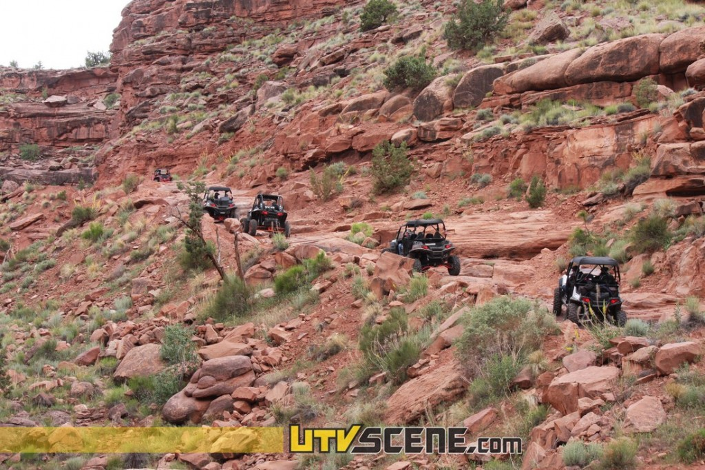 """The next day we were led by the infamous Kent """"the Moab Cowboy"""" Green. Kent took us out on the 'Monitor' and 'Merrimack' trails, along the way we stopped off at 'Determination Towers', a famous & familiar land mark in the world of TV commercials. Kent also led us on 3-D trail and out to 'Tushar Tunnel'. Tushar Tunnel is an incredible natural tunnel carved through solid rock by the forces of water. It is approximately 125' long & is easily accessed by a short 200' hike. Passing through the dark tunnel is an easy mostly level walk and once you reach the other side it opens up to a beautiful wide canyon. The canyon is rimmed in tall colorful sand stone cliffs and cannot be seen without passing through the tunnel, it was definitely a site to see."""