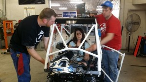 Andy, Jesi and Ben dialing in the machine at Racer Tech