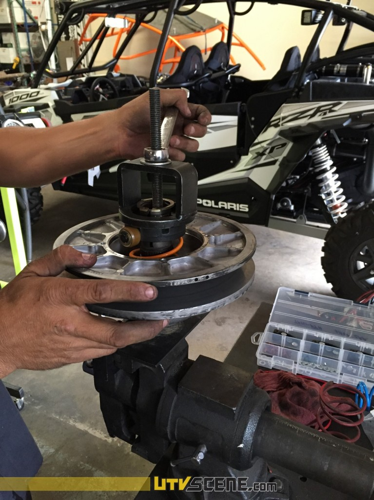 The only tricky part to installing an aftermarket clutch is compressing the springs, here you can see Triumph Motorsports using their spring compression tool to re-install the parts.