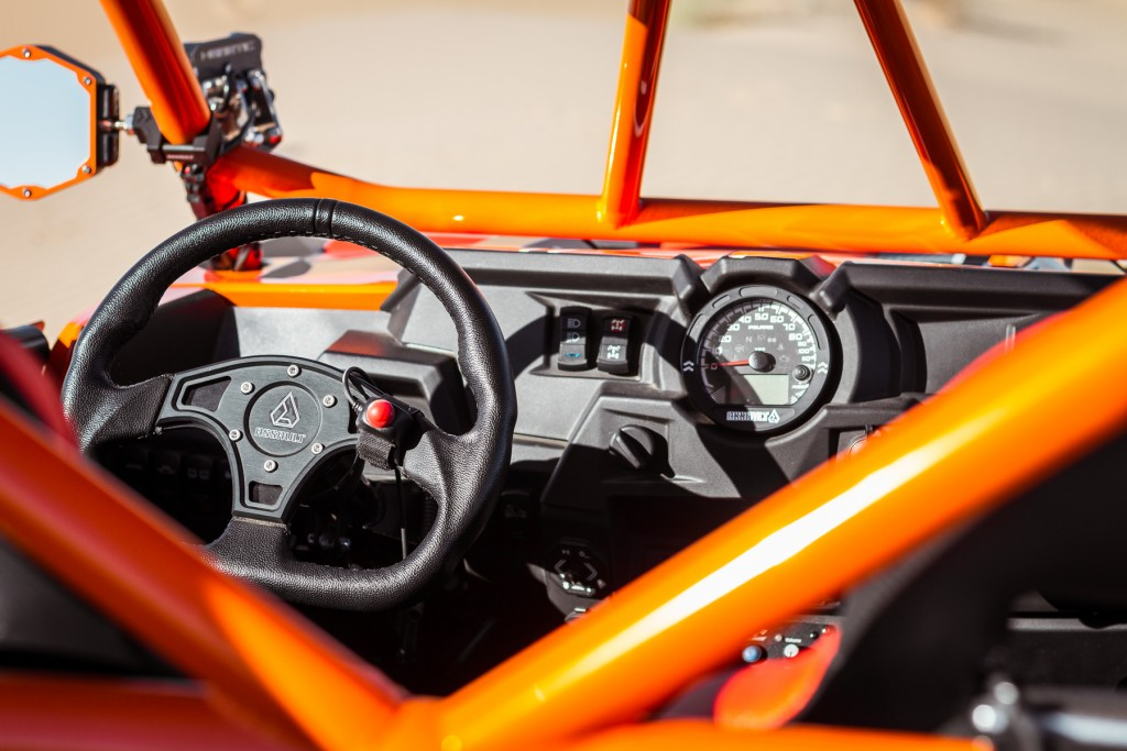 Assault Industries Ballistic D Steering Wheel seen here. An Assault Industries Quick Release Fire Extinguisher Kit and gas cap was also used.