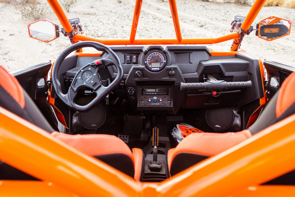 PCI Intercom and Radio with red push to talk buttons. SSV Works MRB2 sound system controller(left of intercom)and SSV Speakers. Assault shifter, speedo bezel, bomber mirrors, and steering wheel.