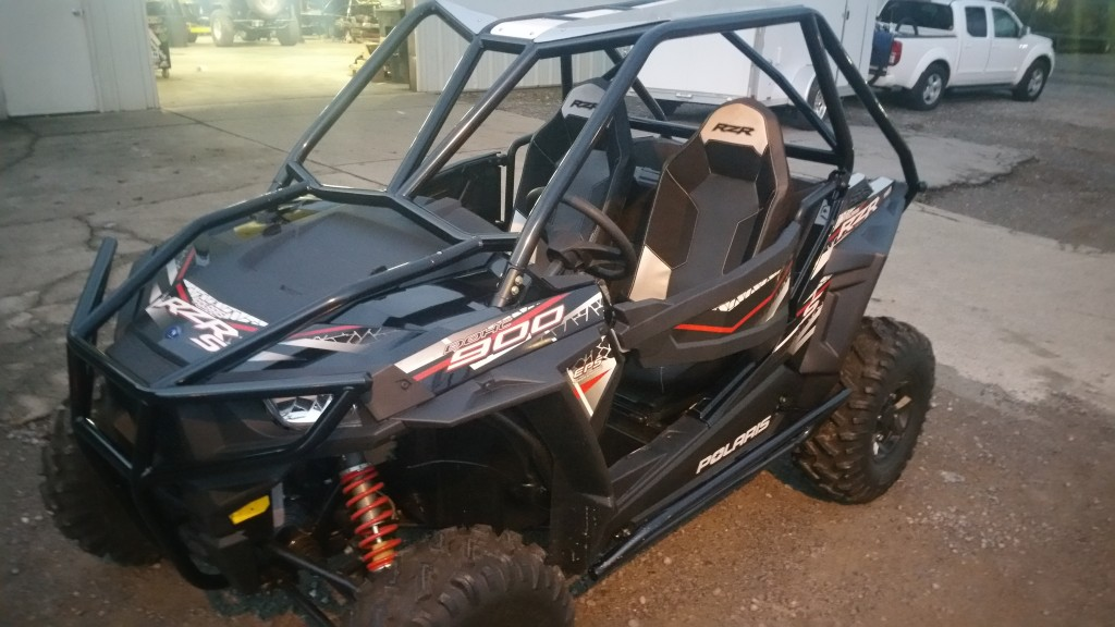 This RZR S900 features Wide Open's Venom cage. As you can see, it looks just as sharp as our Rolled Roof design.